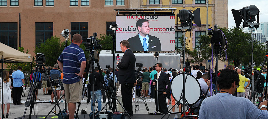 Mobile LED high resolution screen at political rally.